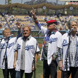The Beach Boys perform before the Los Angeles Dodgers' home-opener baseball game against the Pittsburgh Pirates in Los Angeles, Tuesday, April 10, 2012.
