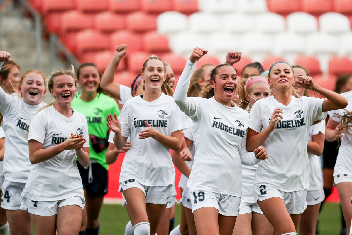 Ridgeline players celebrate their win over Ogden in the 4A girls soccer state championship game at Rio Tinto Stadium in Sandy on Friday, Oct. 23, 2020.