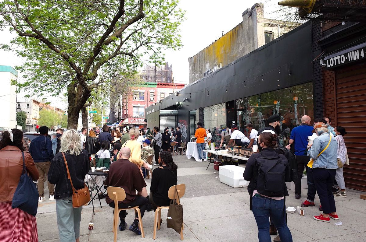 People gather for a block party at a new coffee shop in Crown Heights