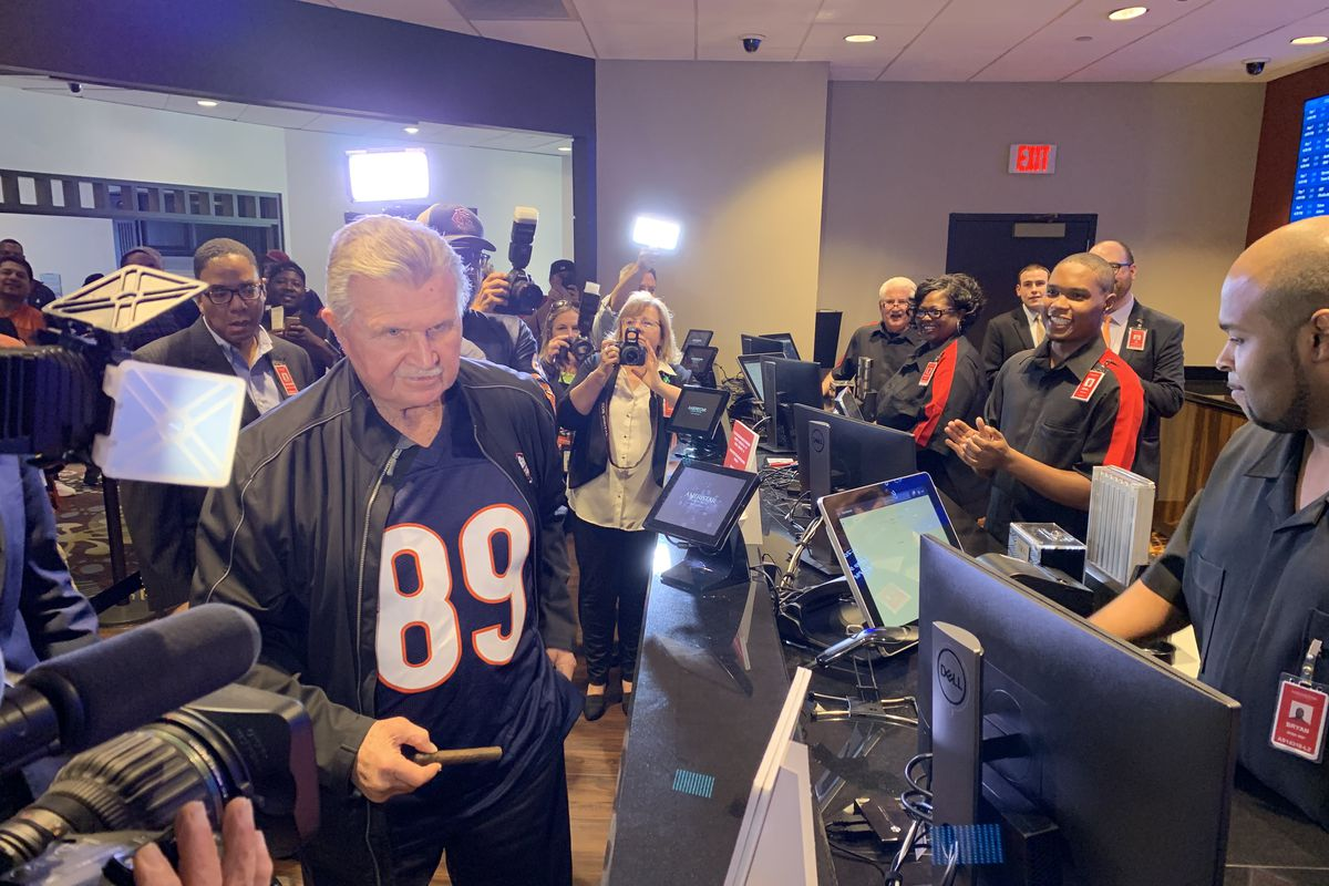 Mike Ditka whips out a cigar before placing a ceremonial first bet at the Ameristar Casino in East Chicago, Ind., Thursday afternoon.