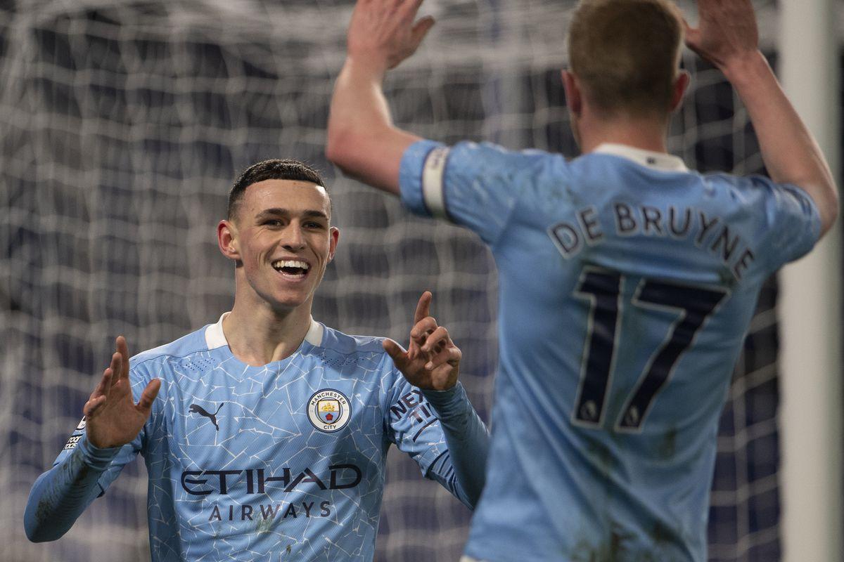 Phil Foden celebrates with Kevin De Bruyne - Manchester City - Premier League