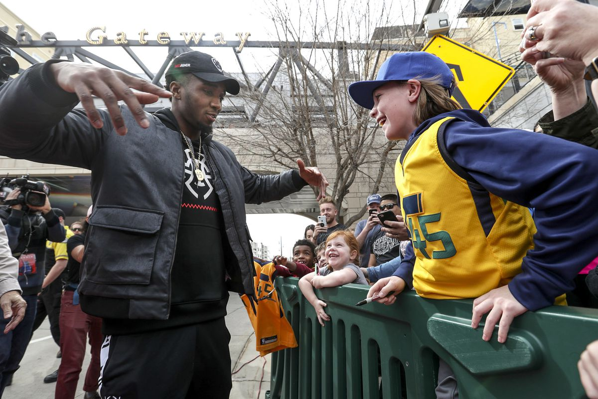 Donovan Mitchell, of the Utah Jazz, embraces his fans after event where the pedestrian bridge spanning 100 south, at The Gateway in Salt Lake City, is named after him on Tuesday, March 26, 2019.