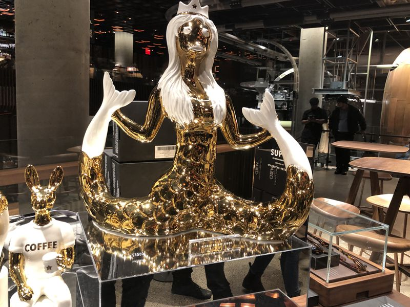 A statue of the Starbucks Mermaid