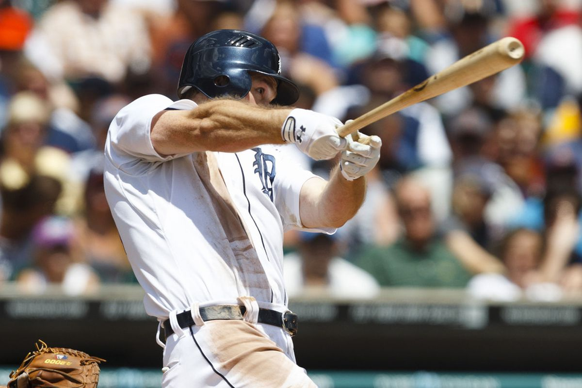 June 7, 2012; Detroit, MI, USA; Detroit Tigers right fielder Brennan Boesch (26) hits an RBI double during the fourth inning against the Cleveland Indians at Comerica Park.