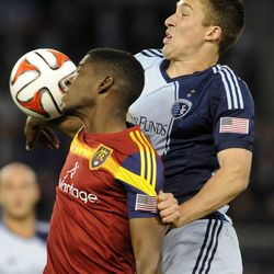 Real Salt Lake's Olmes Garcia heads the ball in front of Sporting KC's Matt Besler during a game at Sporting Park in Kansas City, Kan., on Saturday, April 5, 2014.