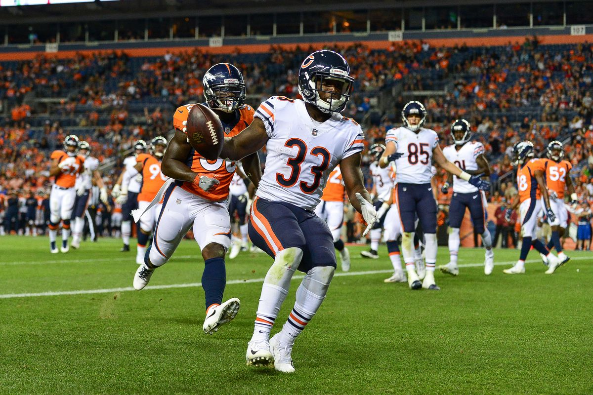 0f7ca0018 Running back Taquan Mizzell  33 of the Chicago Bears scores a fourth  quarter touchdown against the Denver Broncos during an NFL preseason game  at Broncos ...