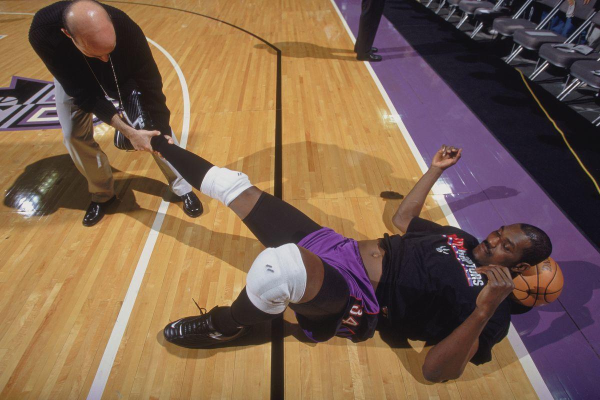 Hakeem Olajuwon stretches before the game
