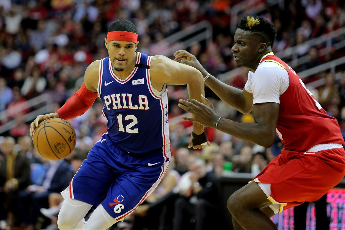 Philadelphia 76ers forward Tobias Harris drives to the basket while Houston Rockets center Clint Capela defends during the game at Toyota Center.