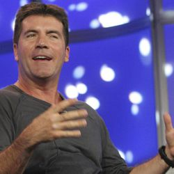 """FILE -  In this Jan. 20, 2007 file photo """"American Idol"""" judge Simon Cowell speaks during the 2007 Fox Winter Press Tour in Pasadena, Calif. A revealing new biography offers intimate, some might say too intimate, details about Simon Cowell, along with a portrait of the entertainment mogul's savvy business side. """"Sweet Revenge,"""" published in the U.S. by Ballantine Books on Tuesday April 21, 2012, is written by British journalist and biographer Tom Bower and is the first book written about Cowell with his participation, though not his authorization."""