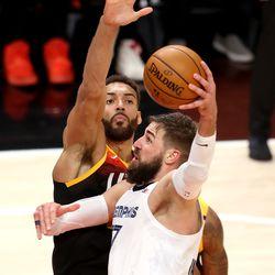 Utah Jazz center Rudy Gobert (27) defends Memphis Grizzlies center Jonas Valanciunas (17) as the Utah Jazz and Memphis Grizzlies play Game 2 of their NBA playoffs first round series at Vivint Arena in Salt Lake City on Wednesday, May 26, 2021. Utah won 141-129.