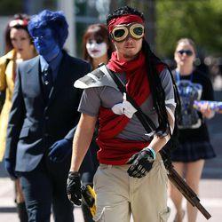 Salt Lake Comic Con attendees walk through downtown Salt Lake City on Saturday, Sept. 6, 2014.