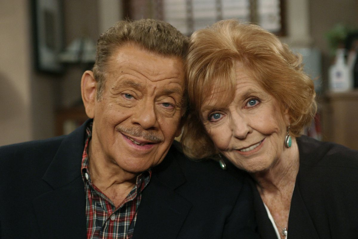 """FILE- In this Nov. 6, 2003, file photo, Jerry Stiller, left, and his wife Anne Meara pose on the set of """"The King of Queens,"""" at Sony Studio in Culver City, Calif. Stiller, a comedy veteran who launched his career opposite wife Meara in the 1950s and reemerged four decades later as the hysterically high-strung Frank Costanza on the smash television show """"Seinfeld,"""" died of natural causes at the age of 92, his son Ben Stiller announced Monday, May 11, 2020. (AP Photo/Stefano Paltera, File)"""
