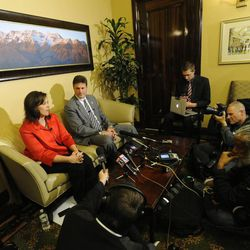 House Speaker Rebecca Lockhart and Investigative Committee Chairman Rep. Jim Dunnigan talk with members of media in the speaker's office at the state Capitol in response to the announcement of Attorney General John Swallow's resignation on Thursday, Nov. 21, 2013.