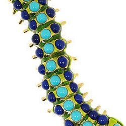 """<a href=""""http://www.net-a-porter.com/product/182124/"""">Kenneth Jay Lane gold plated enamel brooch</a>, $105 at Net-a-Porter"""