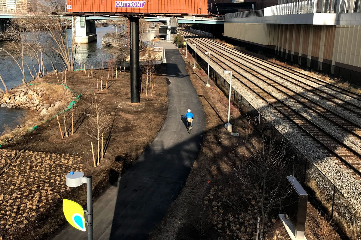 Showing a person biking along the Schuylkill River Trail between South and Christian