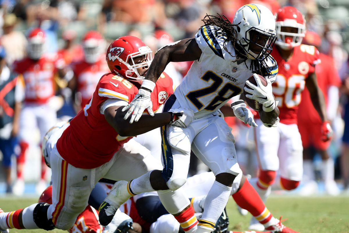 Melvin Gordon of the Los Angeles Chargers gets tackled by Chris Jones of the Kansas City Chiefs during the second quarter at StubHub Center on September 9, 2018 in Carson, California.