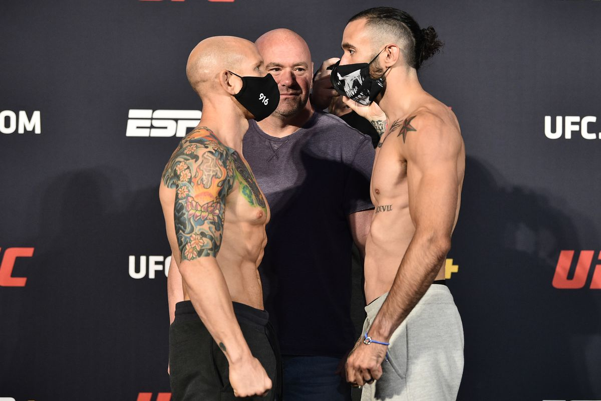 In this handout image provided by UFC, opponents Josh Emmett and Shane Burgos face off during the UFC weigh-in at UFC APEX on June 19, 2020 in Las Vegas, Nevada.