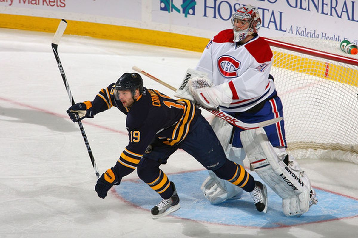 BUFFALO NY - JANUARY 18: Tim Connolly #19 of the Buffalo Sabres is pushed by Carey Price #31 of the Montreal Canadiens at HSBC Arena on January 18 2011 in Buffalo New York.  (Photo by Rick Stewart/Getty Images)