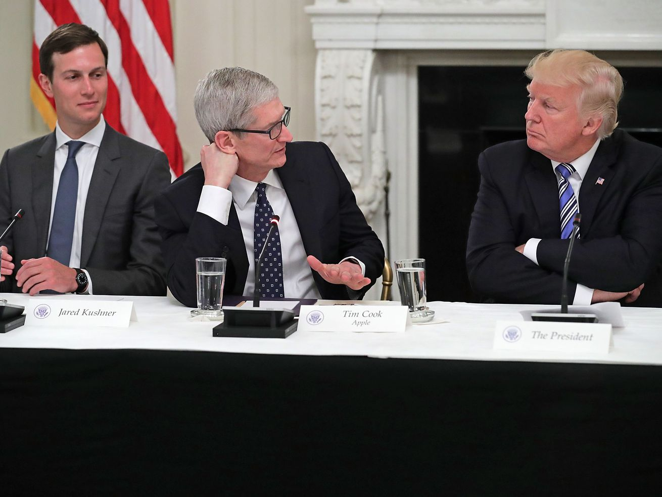 Apple CEO Tim Cook next to President Trump and Jared Kushner at a White House meeting on innovation and technology in June 2017.