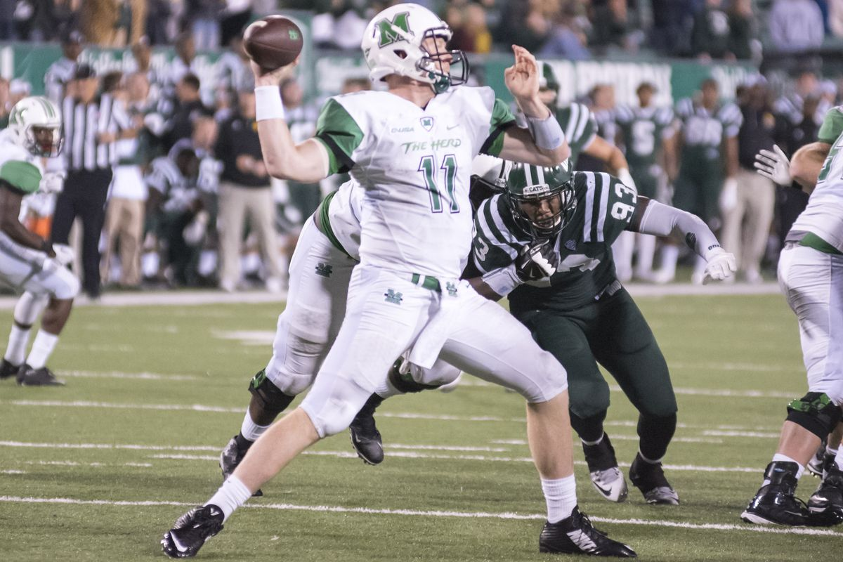 Michael Birdsong (11) fires a pass against Ohio.