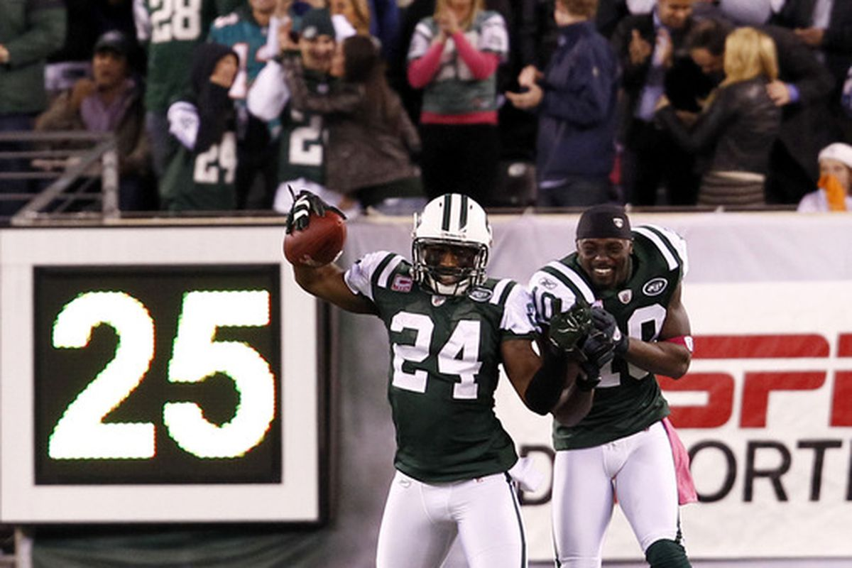 Darrelle Revis (24) and  Santonio Holmes (10) of the New York Jets celebrate Revis' touchdown during their game against the Miami Dolphins at MetLife Stadium on October 17, 2011 in East Rutherford, New Jersey.  (Photo by Jeff Zelevansky/Getty Images)