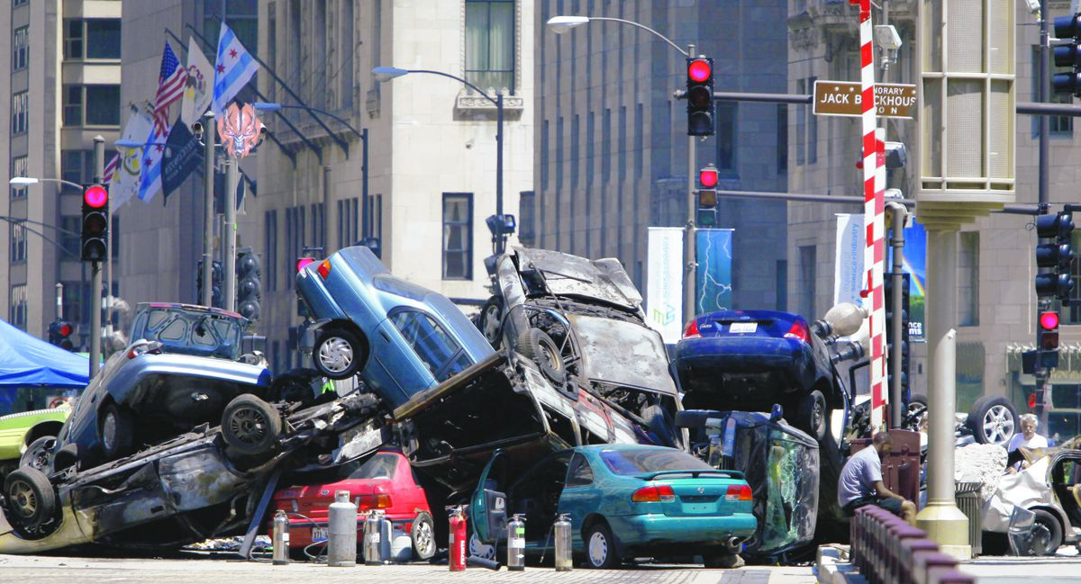 """Cars piled up in a plaza along Michigan Avenue in downtown Chicago, Friday, July 16, 2010, during filming of the movie """"Transformers 3."""""""