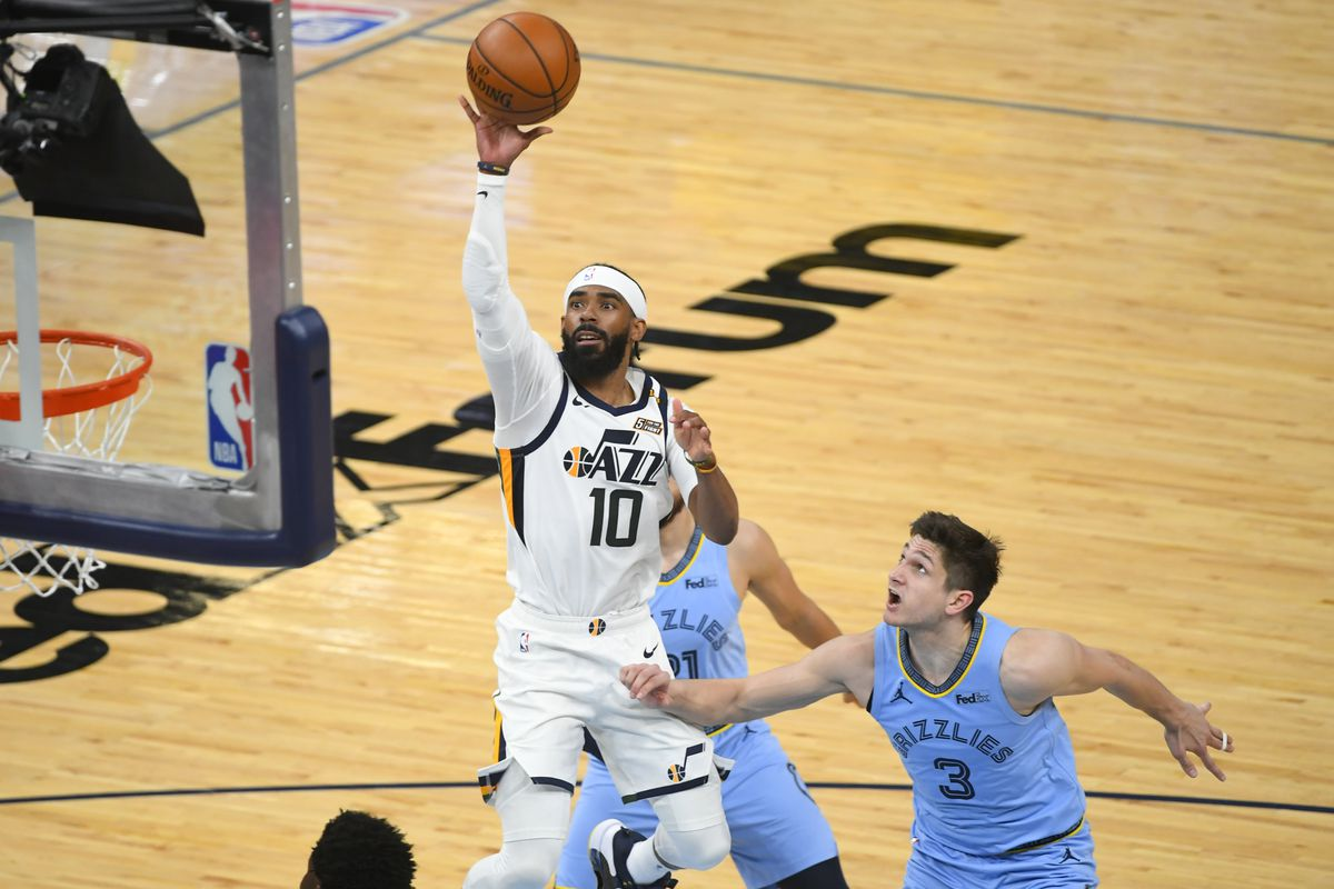 Utah Jazz guard Mike Conley shoots as Memphis Grizzlies guard Grayson Allen defends during Game 3 of their playoff series.