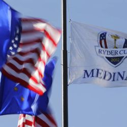 A flag flies over the Medinah Country Club before the Ryder Cup PGA golf tournament Monday, Sept. 24, 2012, in Medinah, Ill.