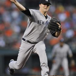New York Yankees starting pitcher Phil Hughes delivers against the Baltimore Orioles in the first inning of a baseball game Friday, Sept. 7, 2012, in Baltimore.