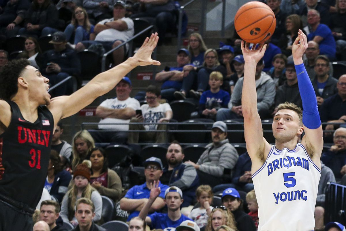 Brigham Young Cougars guard Jake Toolson (5) shoots for three against University of Nevada Las Vegas Rebels guard Marvin Coleman (31) during the second half of a basketball game at Vivint Smart Home Arena in Salt Lake City on Saturday, Dec. 7, 2019.