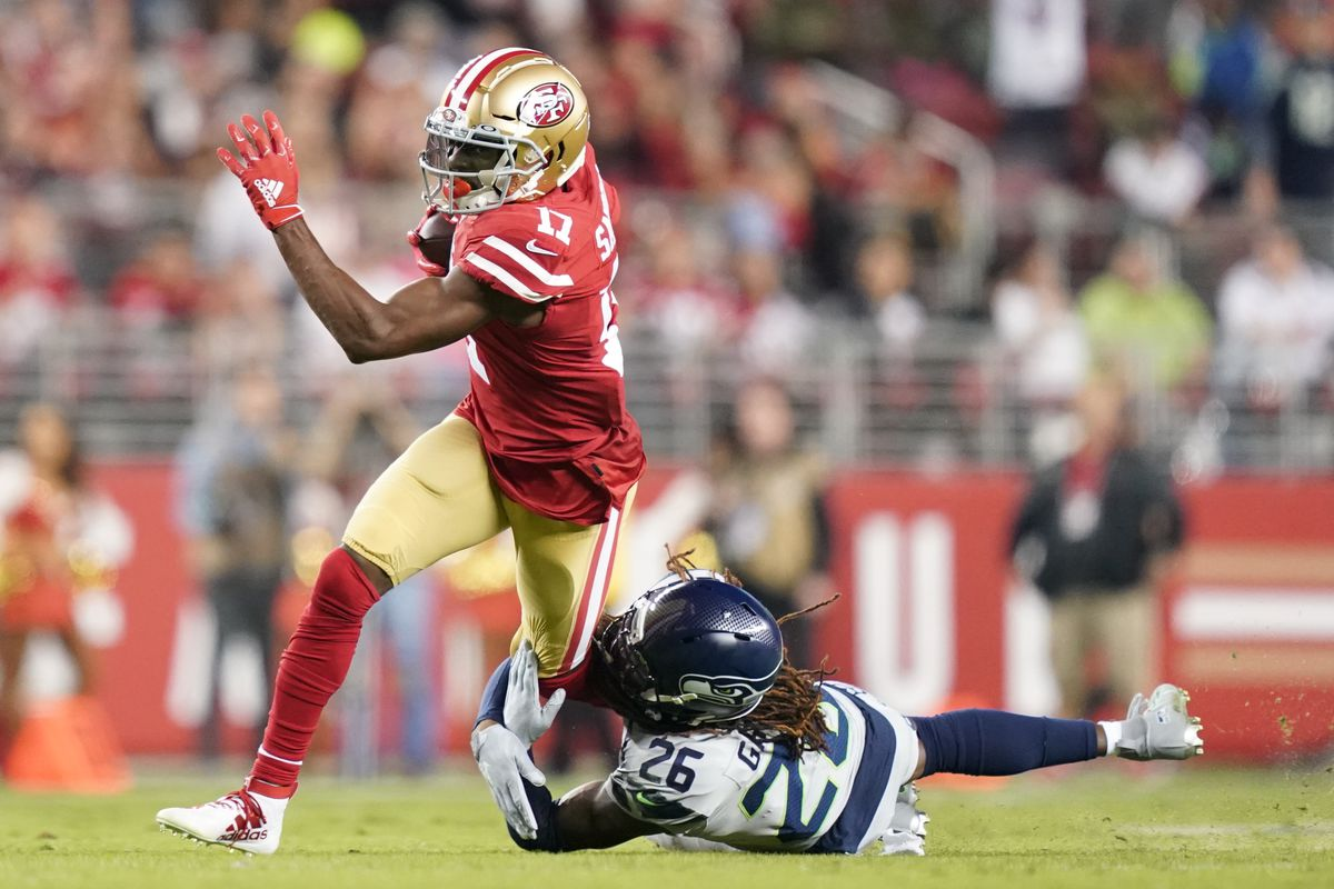San Francisco 49ers wide receiver Emmanuel Sanders is tackled by Seattle Seahawks cornerback Shaquill Griffin during the first quarter at Levi's Stadium.