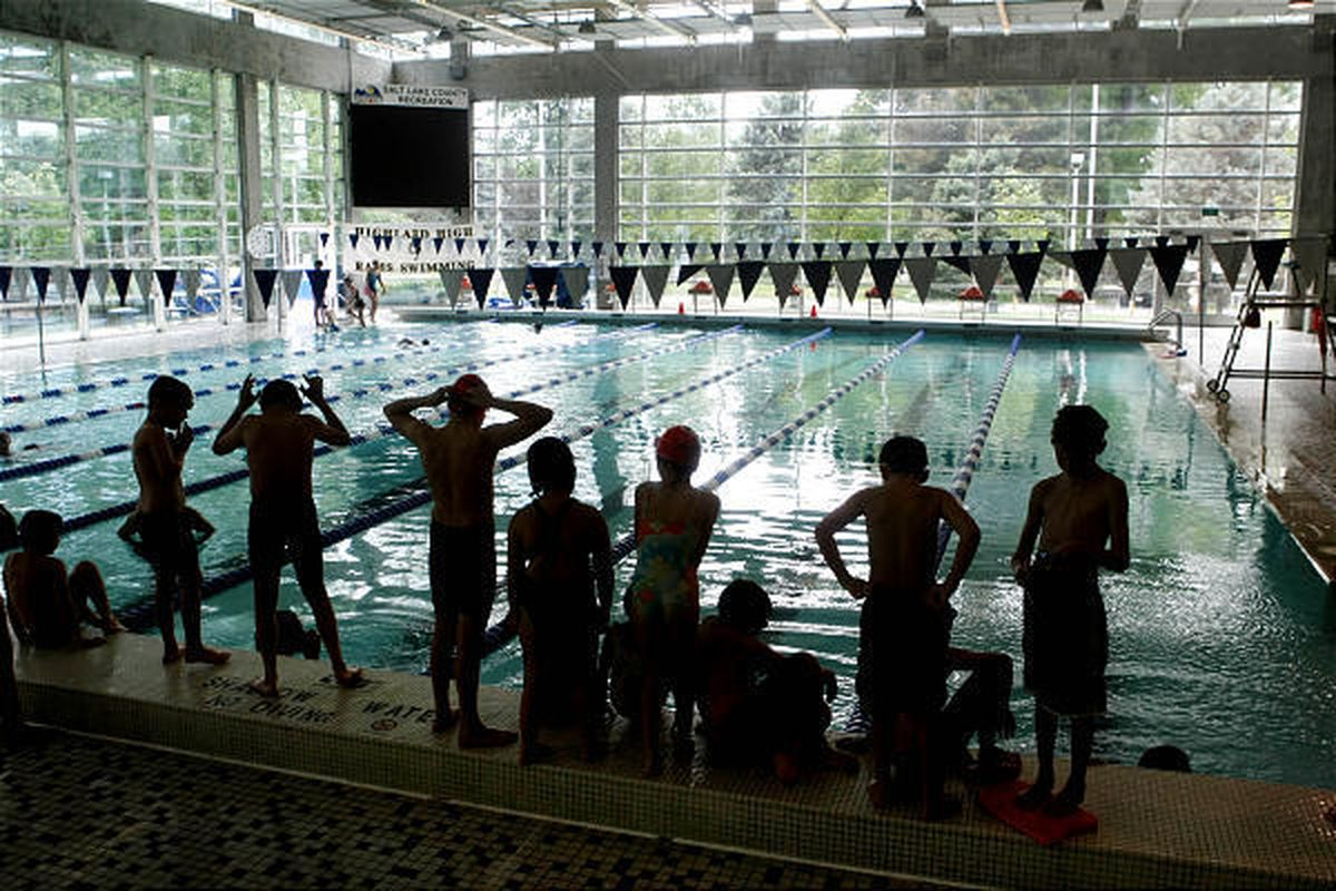 Youngsters participate in a swim class at the Fairmont Aquatic Center on Tuesday.