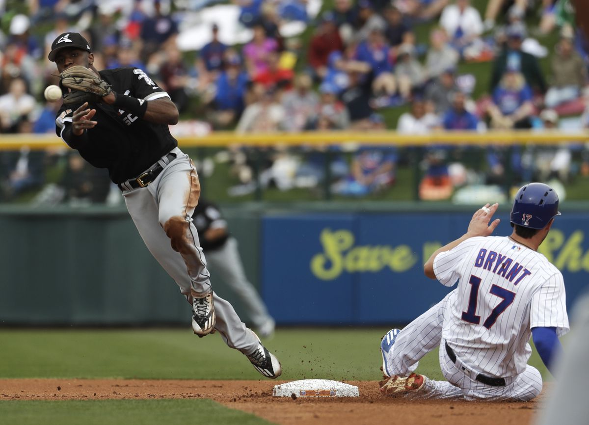 The Cubs' Kris Bryant is out at second as the Sox' Tim Anderson turns a double play on a ball hit by Anthony Rizzo.