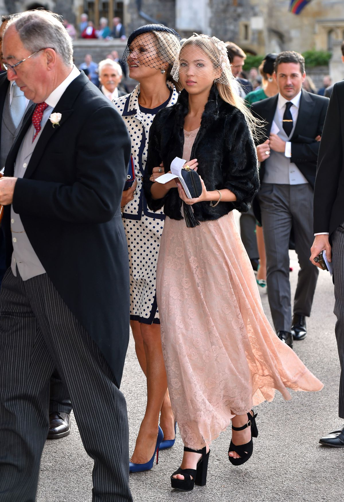 Lila Moss wears a long pink dress, and Kate Moss wears a polka dotted skirt suit.