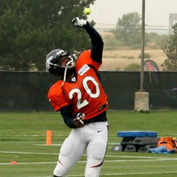 Broncos safety Mike Adams works on hand drills by catching thrown tennis balls.