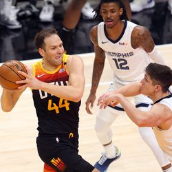 Utah Jazz forward Bojan Bogdanovic (44) takes the ball at Memphis Grizzlies guard Grayson Allen (3) as the Utah Jazz and Memphis Grizzlies play Game 2 of their NBA playoffs first round series at Vivint Arena in Salt Lake City on Wednesday, May 26, 2021.