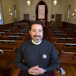 The Rev. Salvatore Sapienza is pictured inside the Douglas Congregational United Church of Christ in the village of Douglas, Mich., on Tuesday Oct. 13, 2020. As part of the Our Faith Our Vote 2020 initiative, volunteers at the church will drive voters with their completed mail-in ballots to the county clerk's office to drop them off in person. The drivers and voters will be masked and separated in vehicles to minimize any COVID-19 risk.