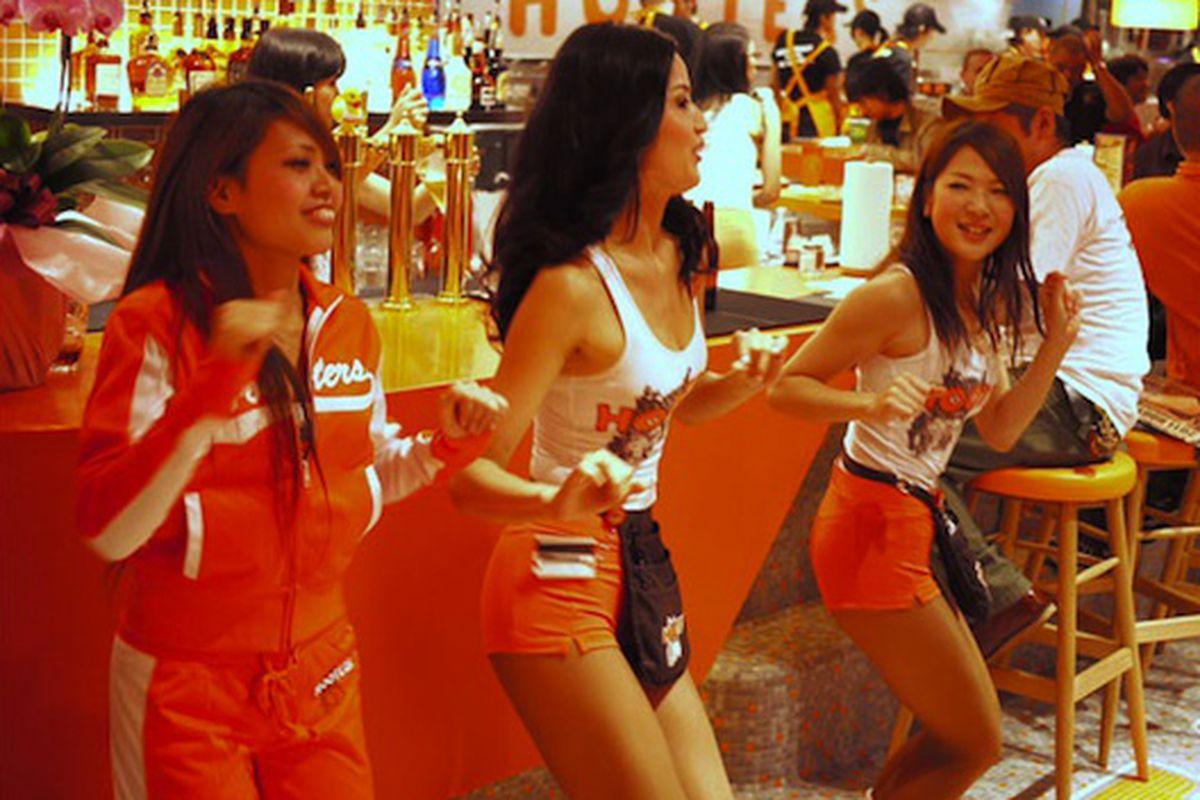 Like a clockwork orange, Japanese Hooters girls move in perfect unison.  Photo: Tokyo Scum Club / Slate.com