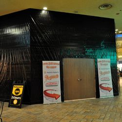 Phase two of the Excalibur food court expansion  hides behind plywood.