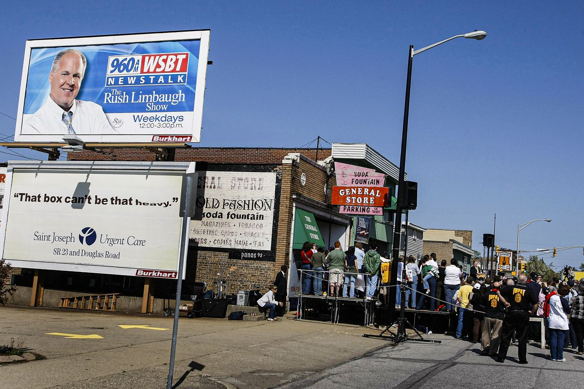 A Rush Limbaugh billboard overlooks a Hillary Clinton campaign event in 2008.
