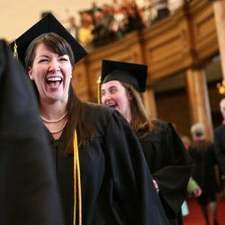 Students make their way into the Tabernacle for the LDS Business College's 126th commencement ceremony on Temple Square in Salt Lake City on Friday, April 12, 2013.