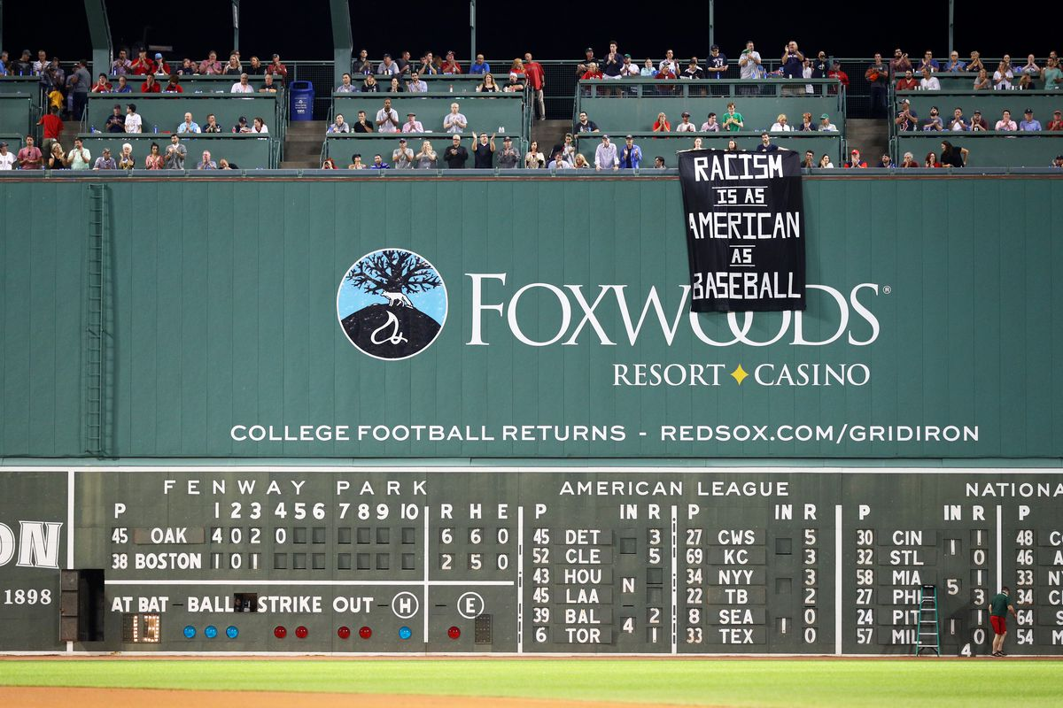 'Racism is as American as baseball' sign hangs at Fenway