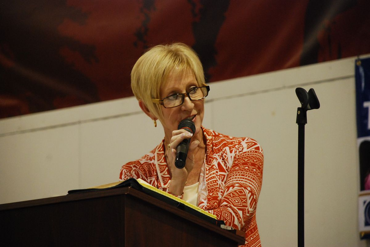 Nora Flood addresses an audience at a school board forum in Jefferson County.