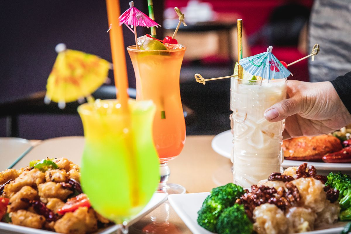 Three tropical drinks with paper umbrellas.