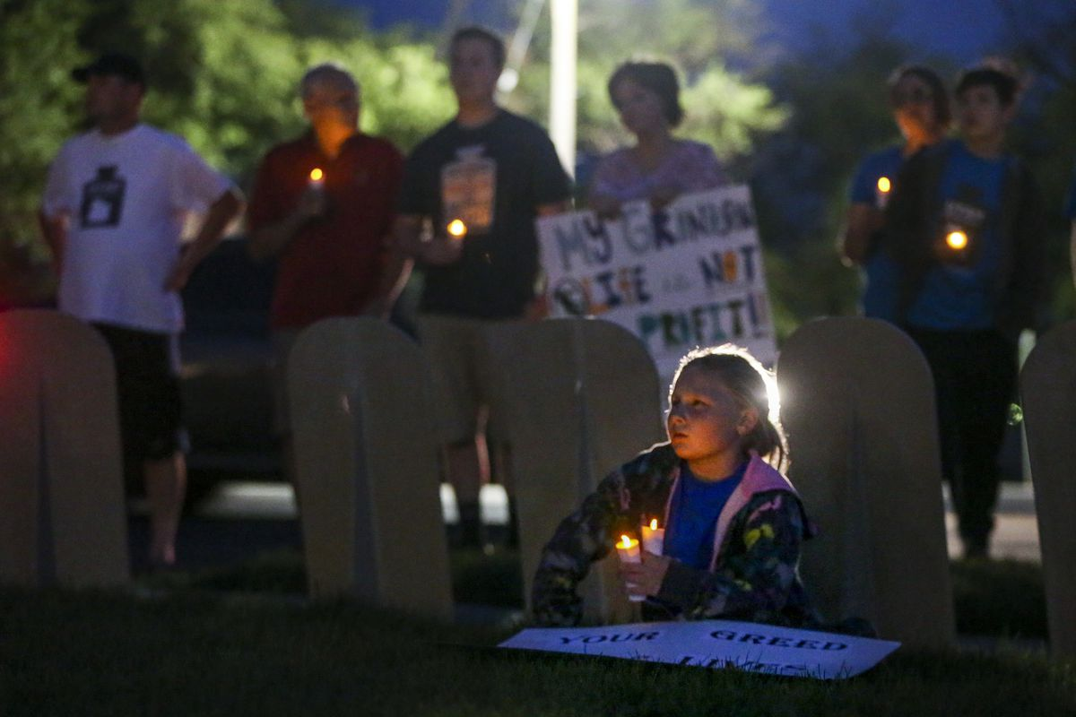 Lucy Thomas, 8, listens to speakers during a vigil held to remember the people that have been lost to Type 1 diabetes and to call for lower prices on insulin in front of the state Capitol in Salt Lake City on Saturday, Sept. 7, 2019. Thomas' cousin died unexpectedly at a young age from what was later diagnosed as Type 1 diabetes and shortly afterward her sister was diagnosed with the same condition.