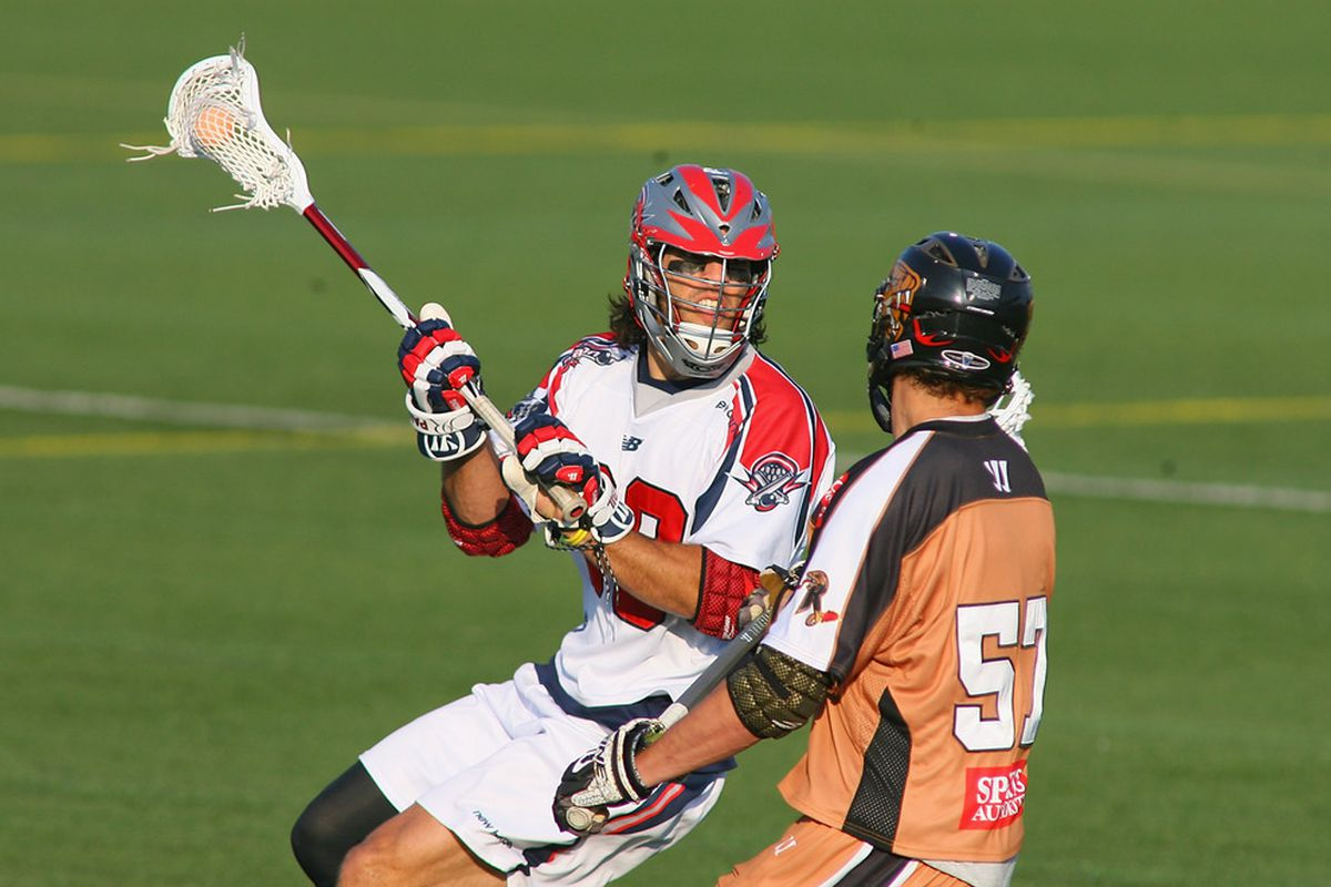 ROCHESTER, NY - JUNE 18:  Paul Rabil #99 of the Boston Cannons plays against Joel White #57 of the Rochester Rattlers at Sahlen's Stadium on June 18, 2011 in Rochester, New York. Boston won 16-14.  (Photo by Rick Stewart/Getty Images)