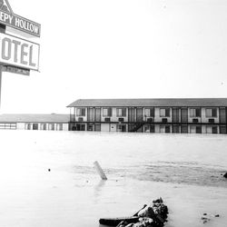 Floodwaters Partially bury the Sleepy Hollow Motel, west of Delta Utah, on US 6, June 1983.