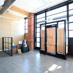The wall in this photo will be knocked down to expand Colt & Gray's dining room.
