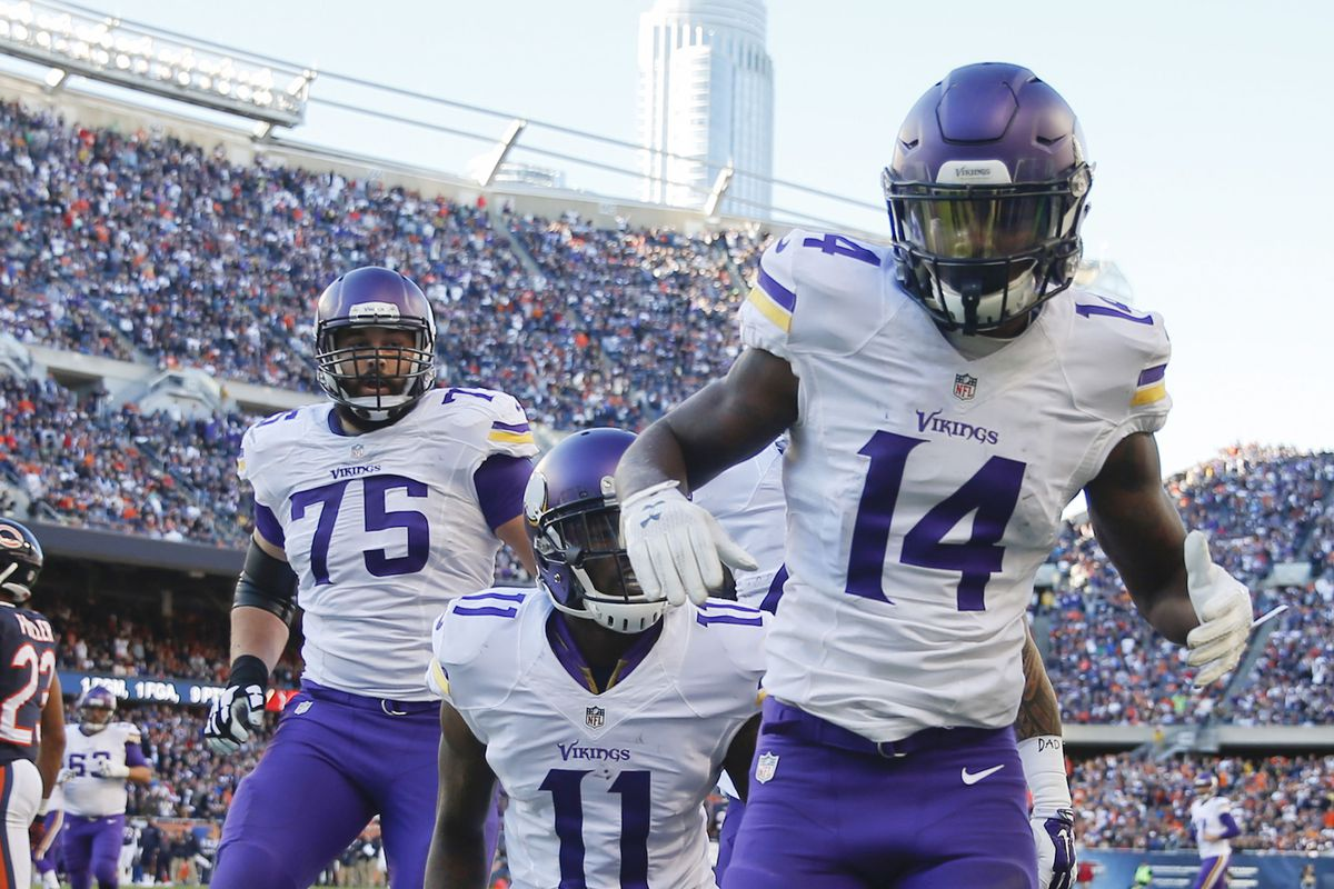 Stefon Diggs celebrates a game-tying touchdown against Chicago on Sunday.