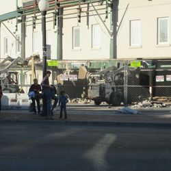 3:18 p.m. Demoltion work taking place in front of the ballpark, at Gate F -